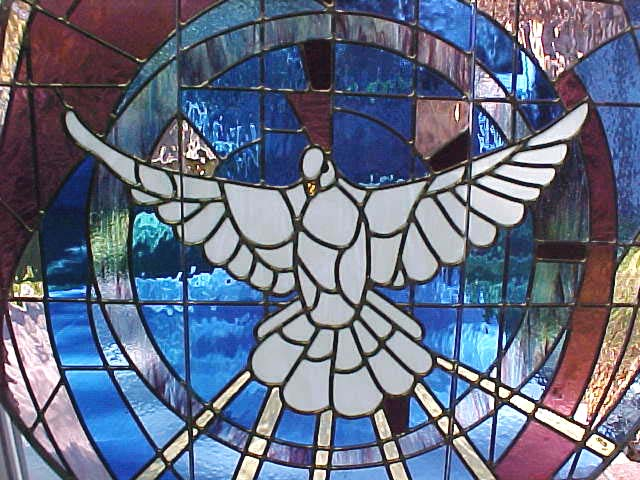 King of Peace's stained glass of the Holy Spirit hovering in creation