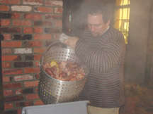 Father Frank dumps a double-sized batch of low country boil