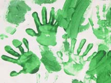 handprints on a large banner made during Kids in the Kingdom Week